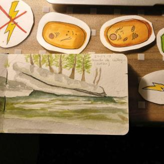 sketchbook and watercoloured cells for a children's board game